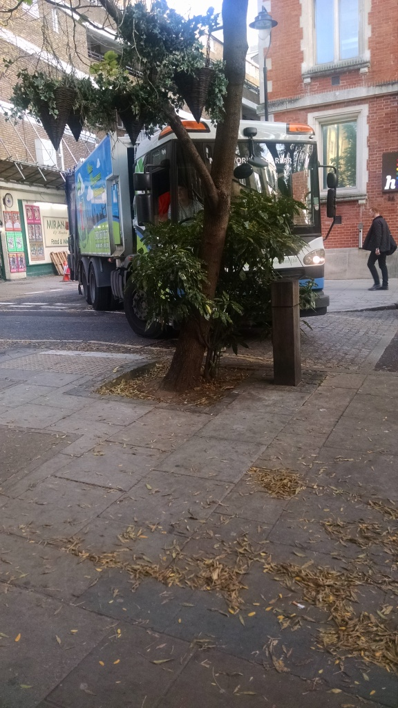 garbage truck in London stuck turning a corner