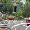 Bike in front of demolished house
