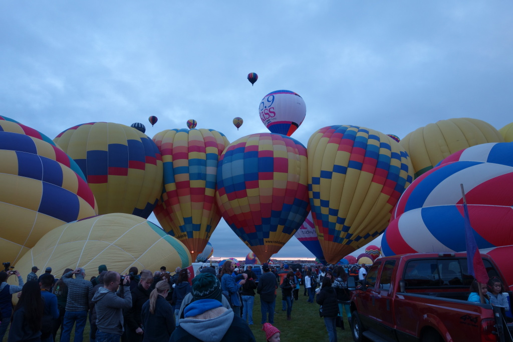 Row of hot air balloons very close together
