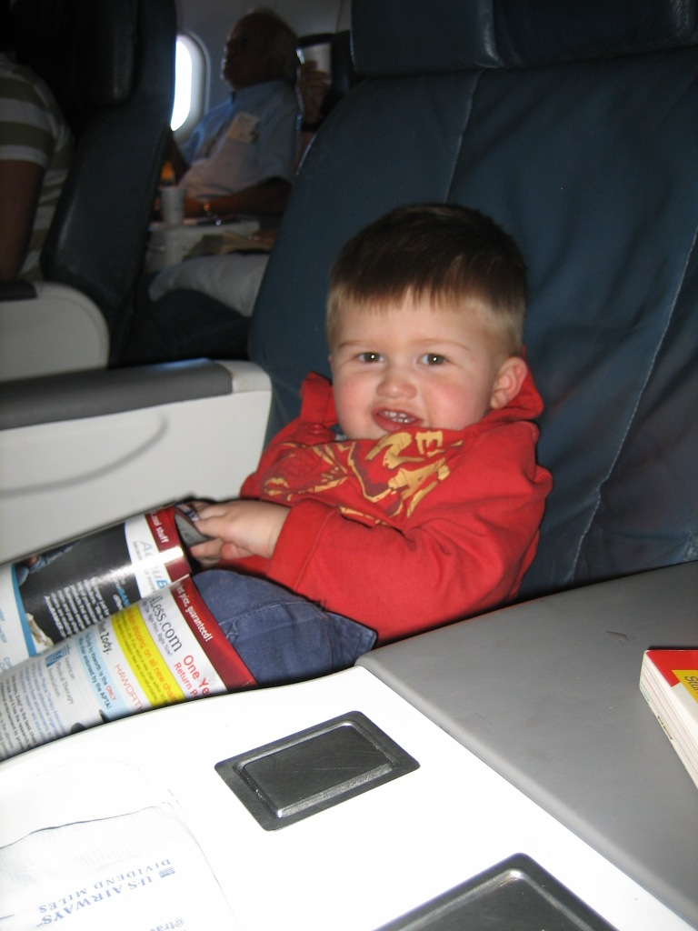 small child in a business class airline seat