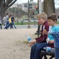 kids sitting on a bench on the Mall